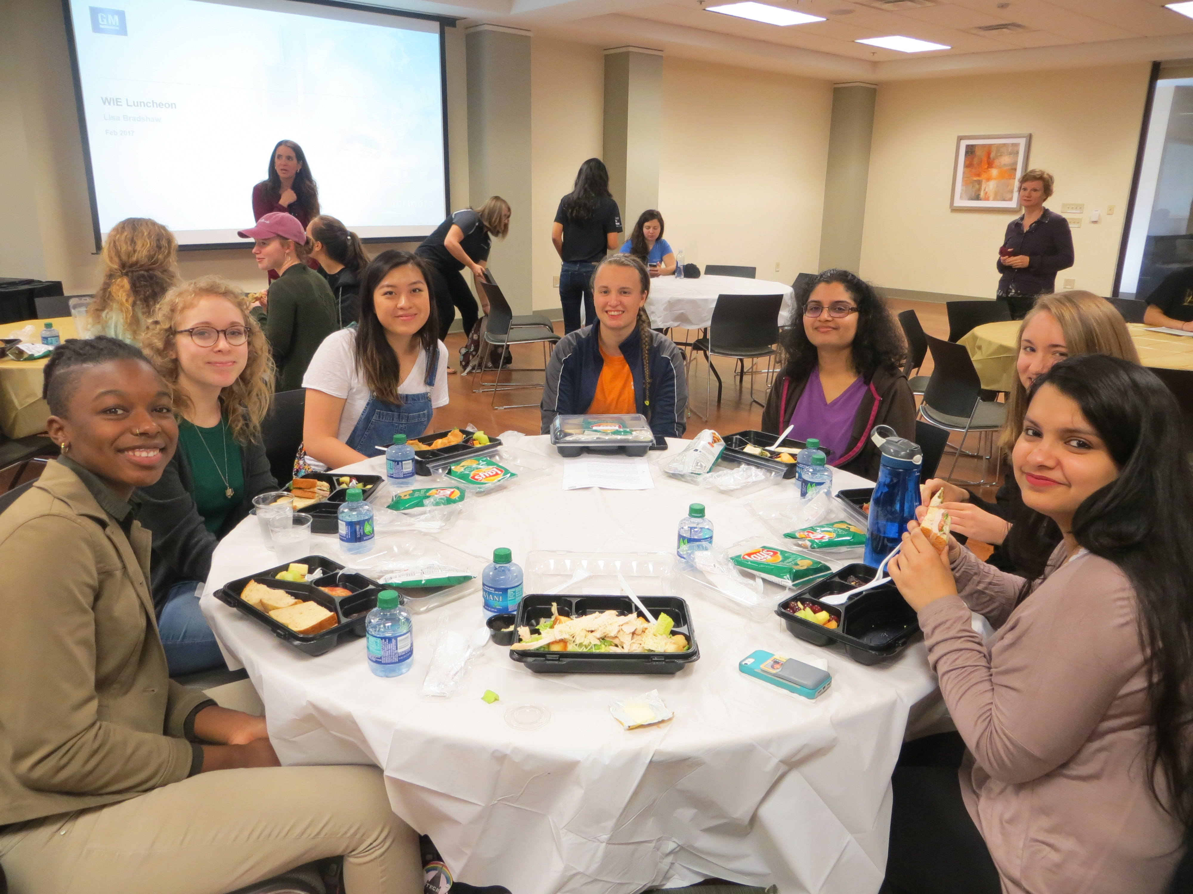 Students eating lunch at GM information session